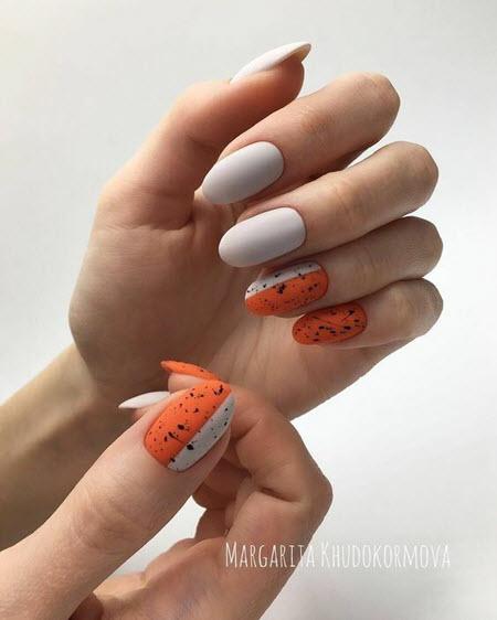 Стильный оранжевый осенний маникюр: фото новинки 2021