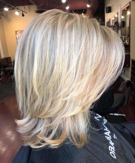Женская стрижка каскад на средние волосы