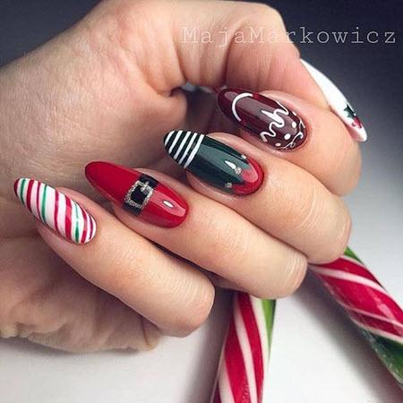 Идеи красного маникюра на зиму Рождественские мотивы красиво иллюстрированные на кончиках пальцев в красном цвете украсят ваш зимний маникюр.